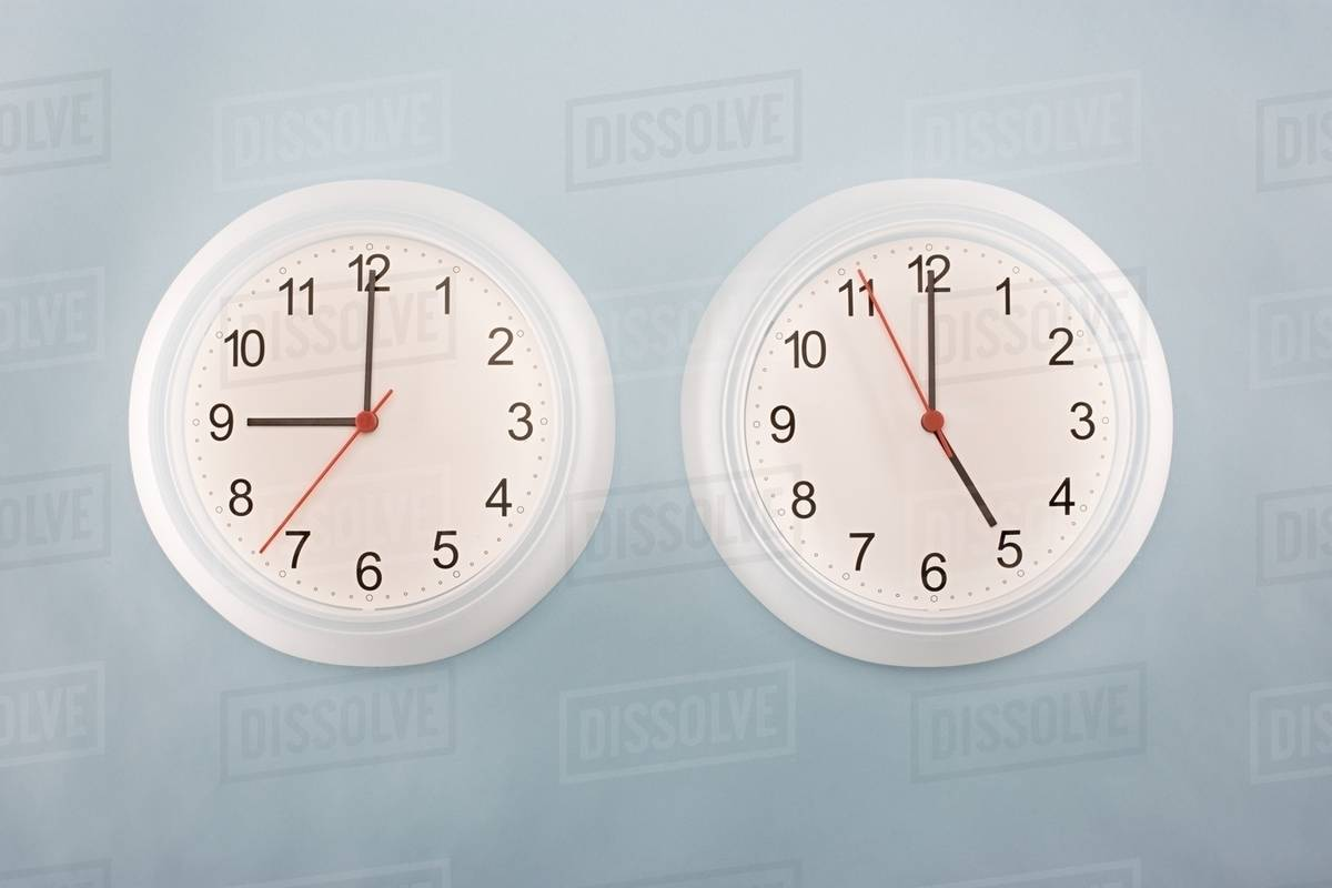 two clocks stock photo