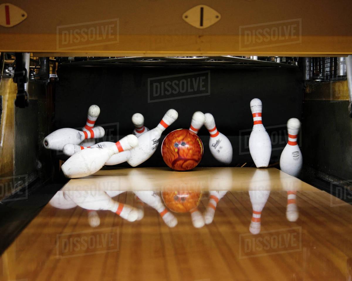 bowling pins falling stock