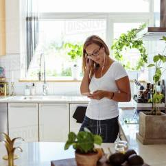 Kitchen Phone Sinks At Menards Woman Listening Music Through Mobile While Standing In