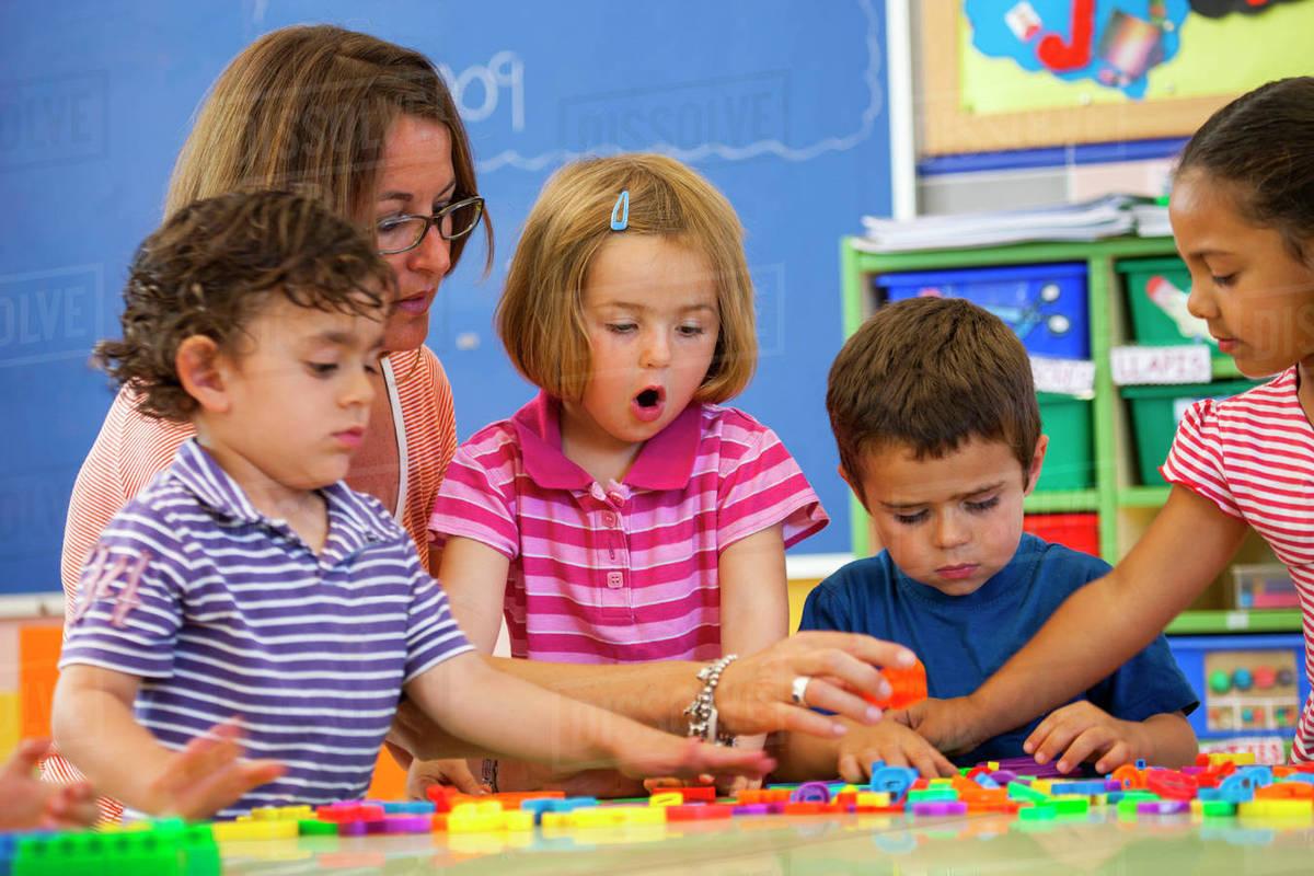 female teacher with preschool