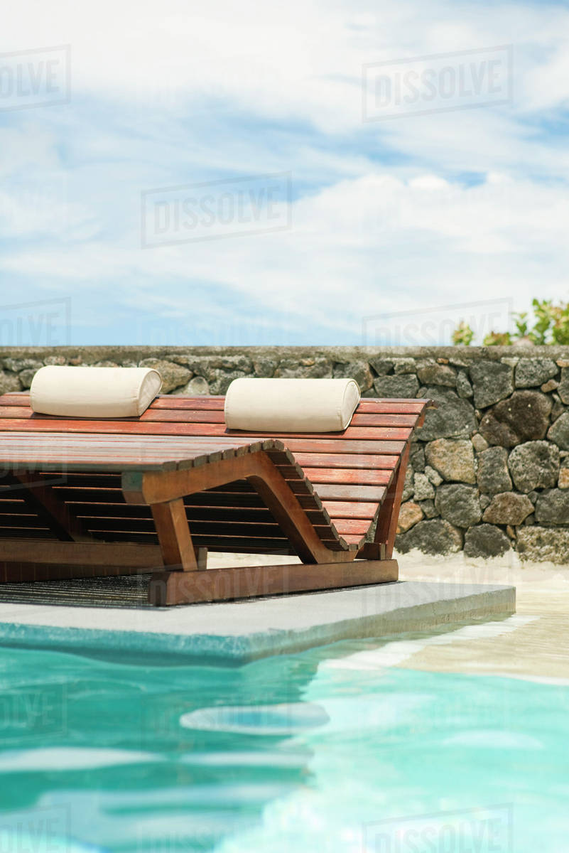 Chairs For Pool Wooden Lounge Chairs In Pool Stock Photo