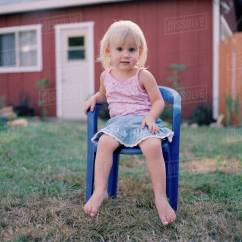 Little Girl Chairs Snorlax Bean Bag Chair Review A Sitting On Plastic In Yard Stock Photo