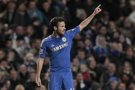 Chelsea's Juan Mata celebrates his goal against Manchester United during their English Premier League soccer match at Stamford Bridge, London, Sunday, Oct. 28, 2012.