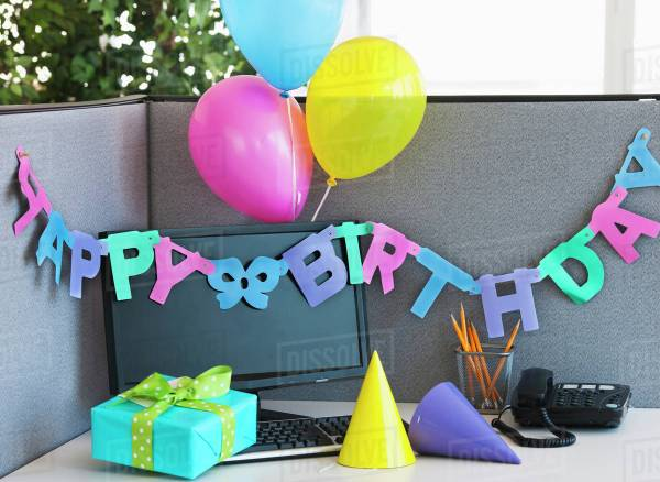 office birthday decorations Close up of birthday decorations on office desk - Stock Photo - Dissolve