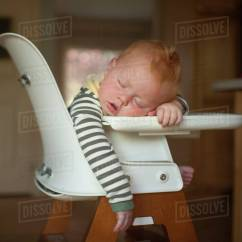 Baby Sleeping Chair Desk And Set Argos Cute Boy On High At Home Stock Photo Dissolve
