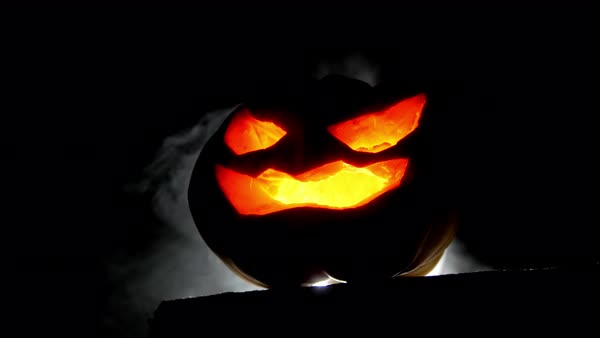 Big Scary Halloween Pumpkin With Luminous Eyes And Smoke With Back Light Stock Video Footage Dissolve