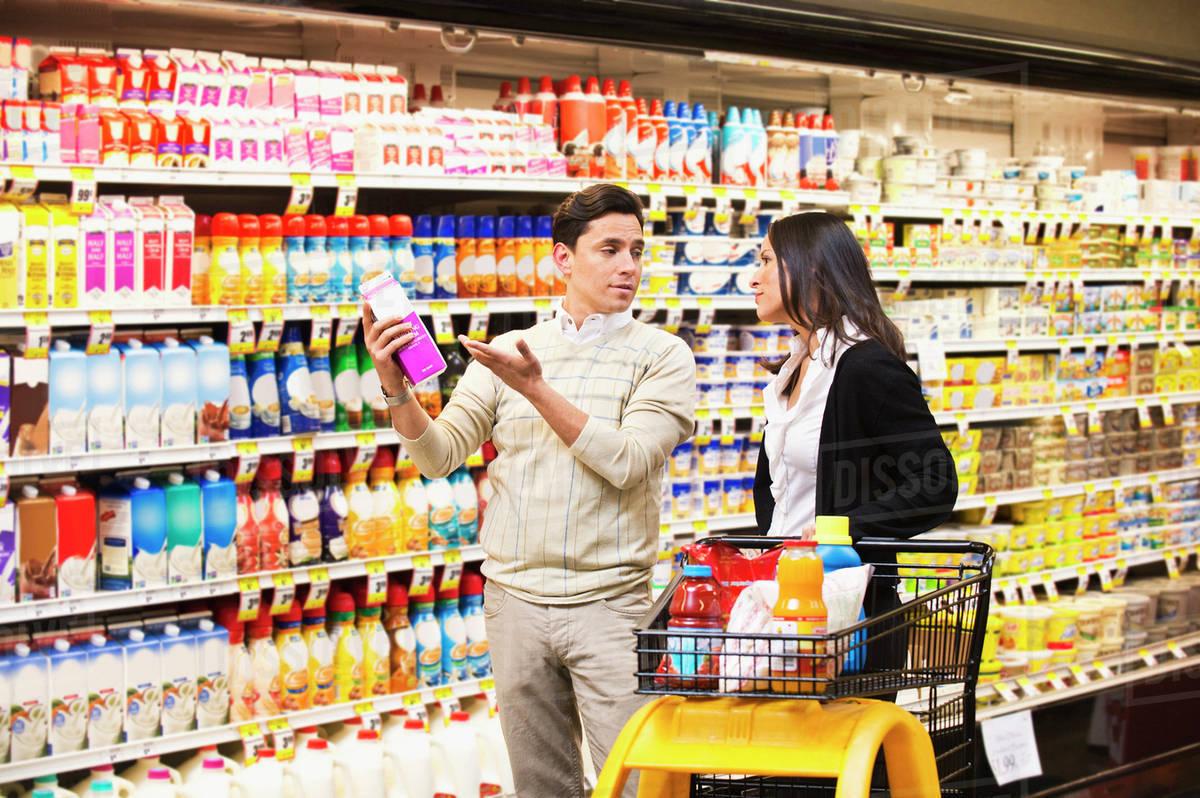 hispanic couple shopping in