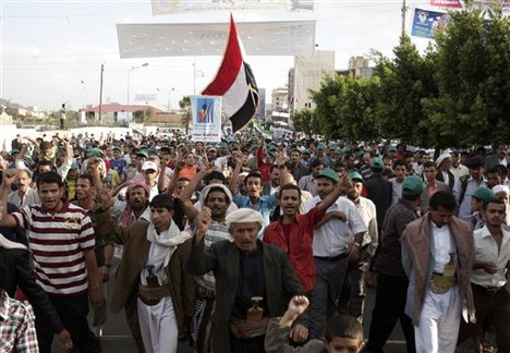 Protestors march while chanting slogans during a demonstration demanding the trial of Yemen's former President Ali Abdullah Saleh in Sanaa, Yemen, Tuesday, Sept. 4, 2012. Saleh stepped down on February after more than a year of country-wide protests demanding his resignation.