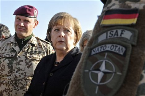 Picture provided by the press department of German Government, shows German Chancellor Angela Merkel , center, as she talks with German soldiers in Kunduz, northern Afghanistan Saturday Dec 18, 2010.