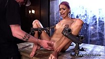Skinny cute slave in metal device pussy fucked with dildo and makes squirt
