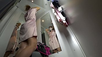 Bokep A hidden camera spies on a sexy girl in a public locker room at the mall, gorgeous ass and long legs, bottom view.