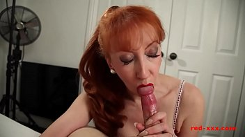 Busty redhead MILF Red jerks her mans cock before riding it