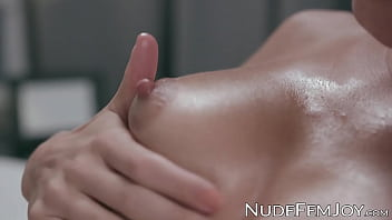 Oiled up stunner teases her small pussy