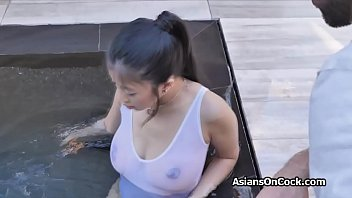 Oiled curvy Asian hottie tit fucks and blows big dick outdoors poolside