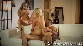 Two busty blonde pornstars take turns having their holes filled by a big cock