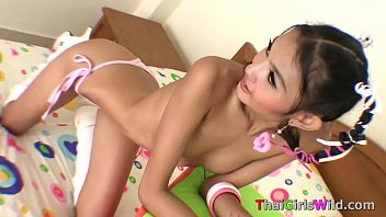 Tiny little Thai teenager poses for the camera