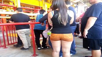 Big butt in orange shorts