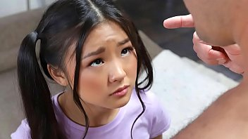 Teenie asian with ponytails messing around in the living room gets surprised by a naked man.