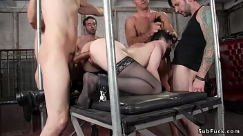 Slim brunette babe in black stockings Audrey Noir with fake big tits gets mouth baned then double penetration fucked by Ramon Nomar and his pals