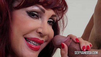 Sexy mature redhead with big tits has her mouth and pussy fucked by a big dick