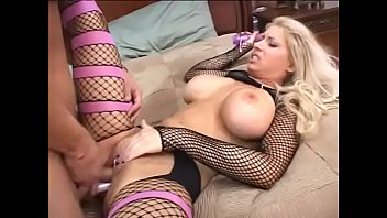 Dixie blonde Candy Manson  in fishnet stockings has fun with dick and dildo combo  in her crack
