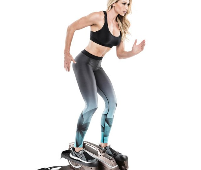 Bionic Body Compact Elliptical Trainer With Resistance Tubes In Use By Kim Lyons While Standing