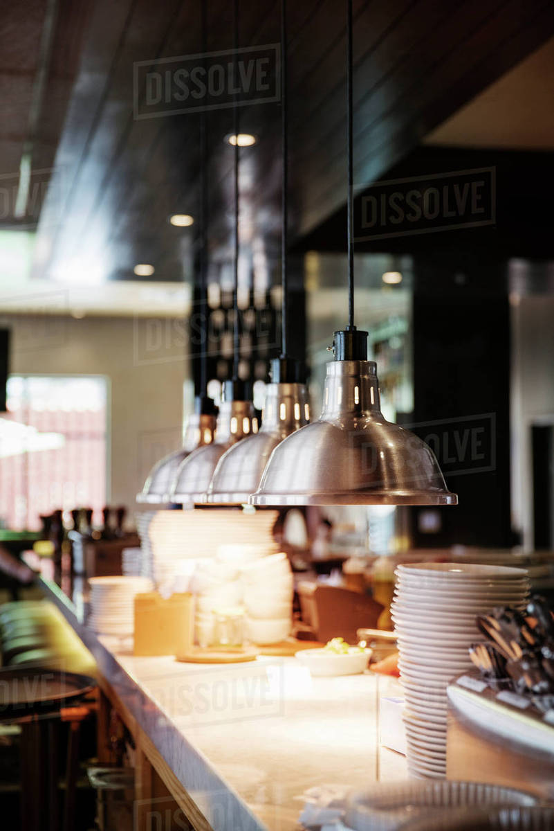pendant lights hanging over counter in commercial kitchen d1061 55 132