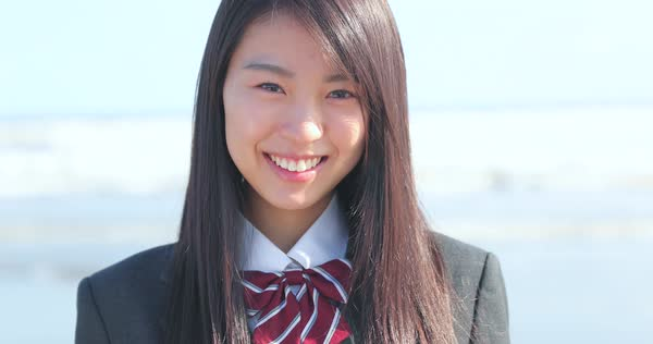 Japanese Girl In School Uniform Smiling At The Camera On D112 71 050