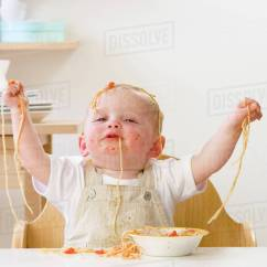 Baby Chairs For Eating Convertible High Chair To Table And Messy Boy In Spaghetti Stock Photo Dissolve