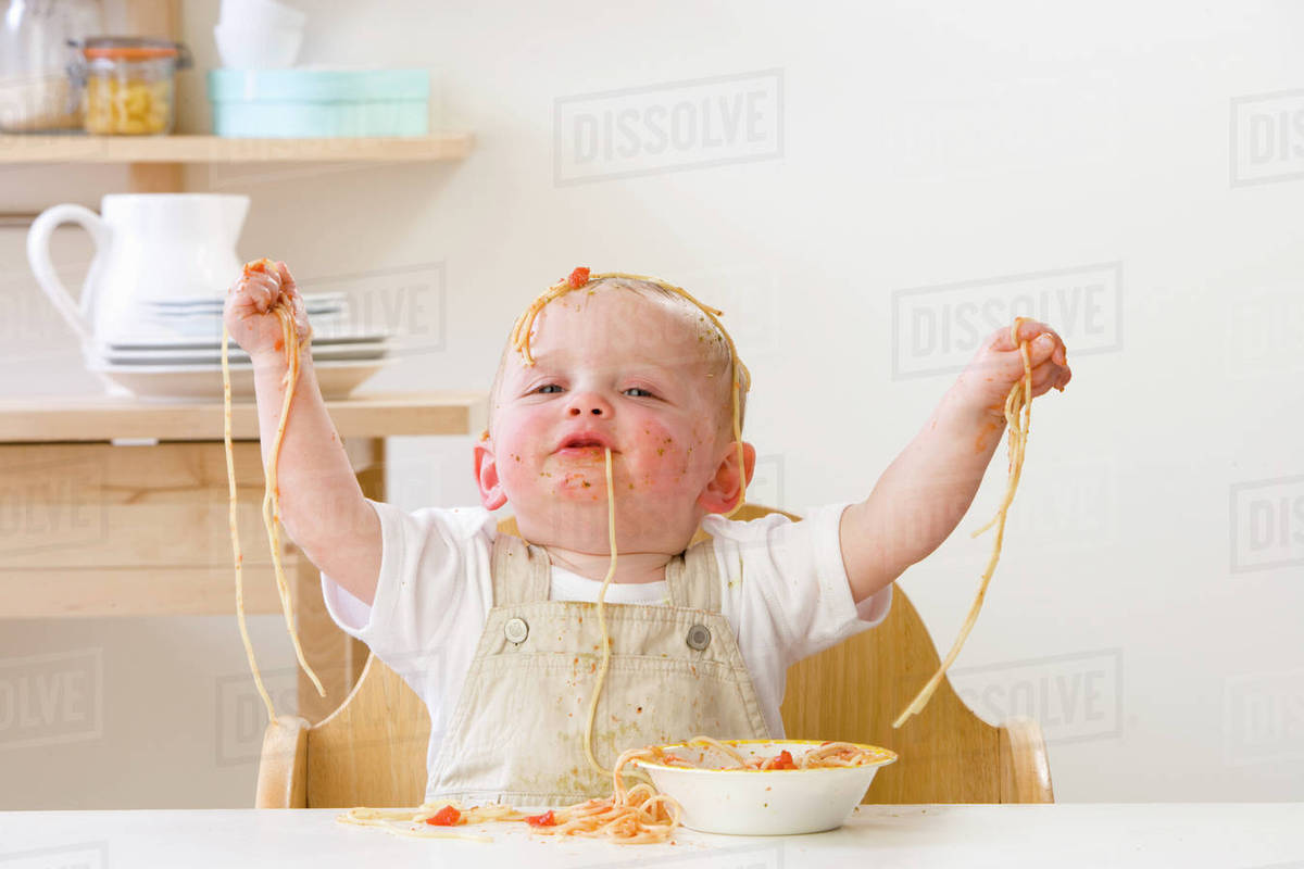 Baby Food Chair Messy Baby Boy In High Chair Eating Spaghetti Stock Photo