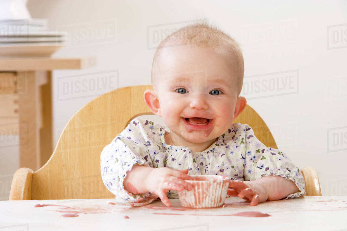baby girl chair folding table with chairs stored inside messy in high eating stock photo dissolve