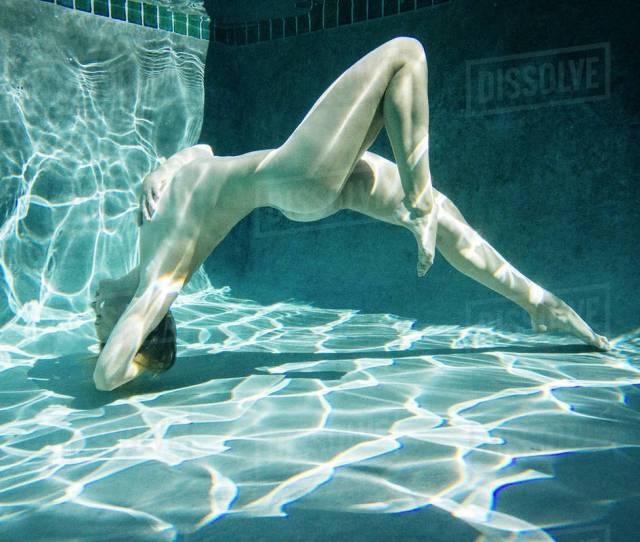 Naked Caucasian Woman Swimming Underwater Stock Photo Dissolve