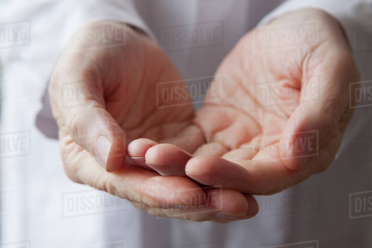 cupped hands of hispanic