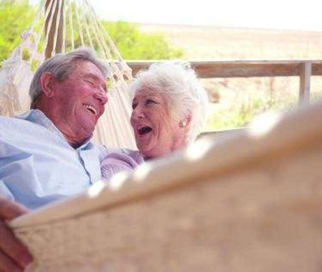 Slow Motion Video Of A Loving Retired Senior Couple Swinging In Hammock And Laughing Together Stock Video Footage Dissolve