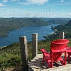 Red Adirondack Chairs Folding Outdoor Furniture Two On A Wooden Deck Overlooking Bonne Bay Newfoundland And Labrador Canada