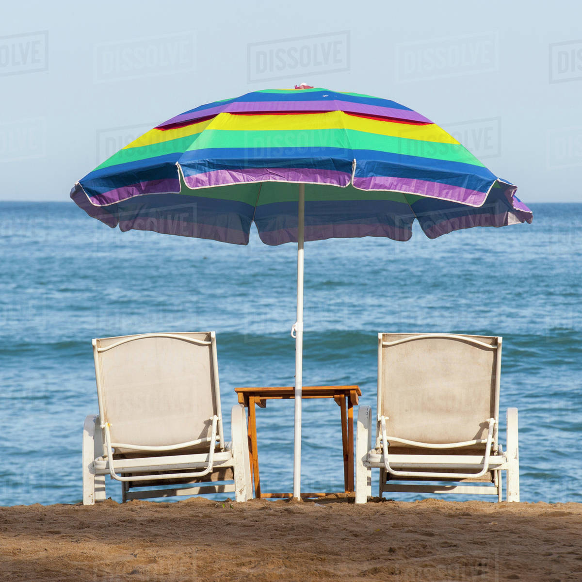 Beach Chairs With Umbrella A Rainbow Beach Umbrella Over Two Lounge Chairs On The Beach At The Water S Edge Sayulita Mexico Stock Photo