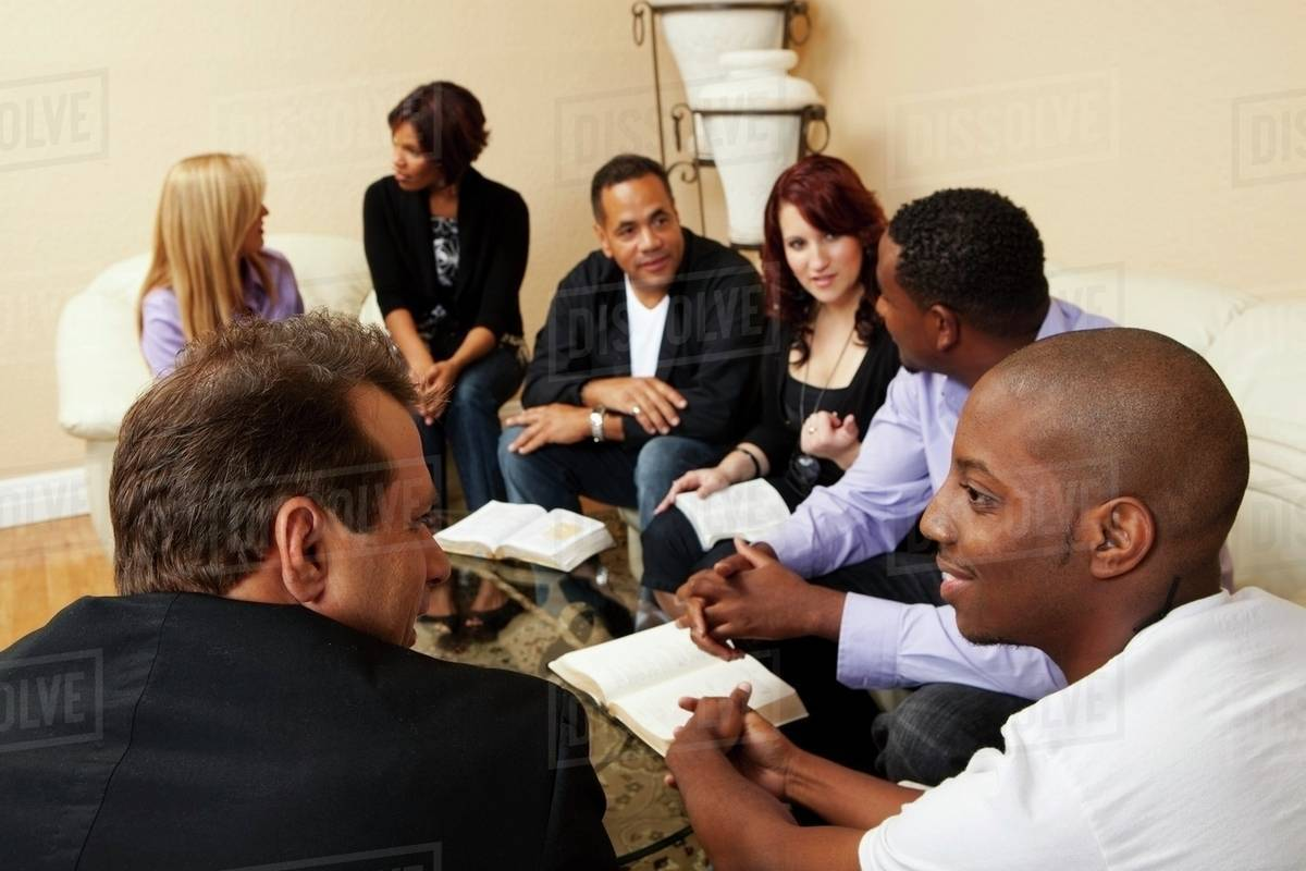 A Group Of Adults In A Home Bible Study