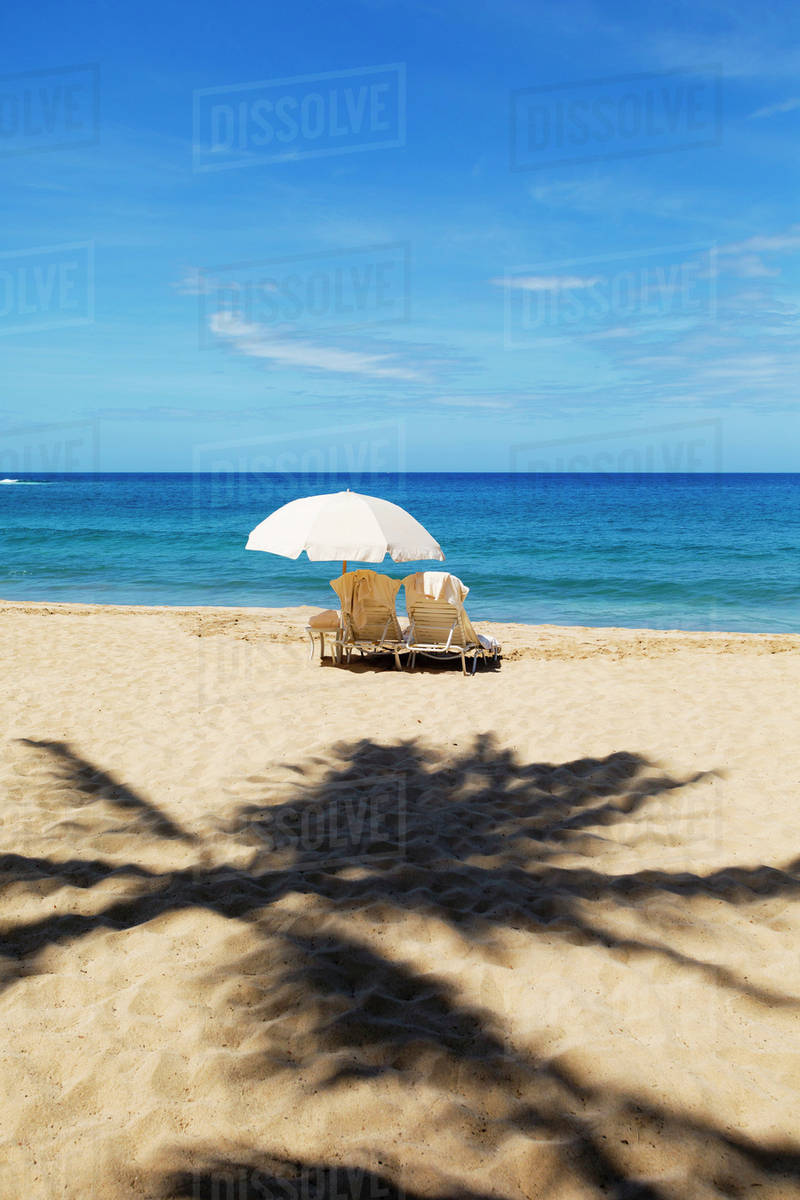Beach Chairs With Umbrella Two Beach Chairs With Umbrella On Hulupo E Beach Manele Bay Lanai Hawaii United States Of America Stock Photo