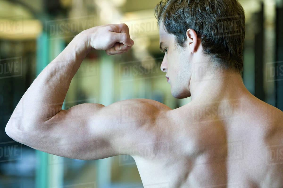 young man flexing bicep