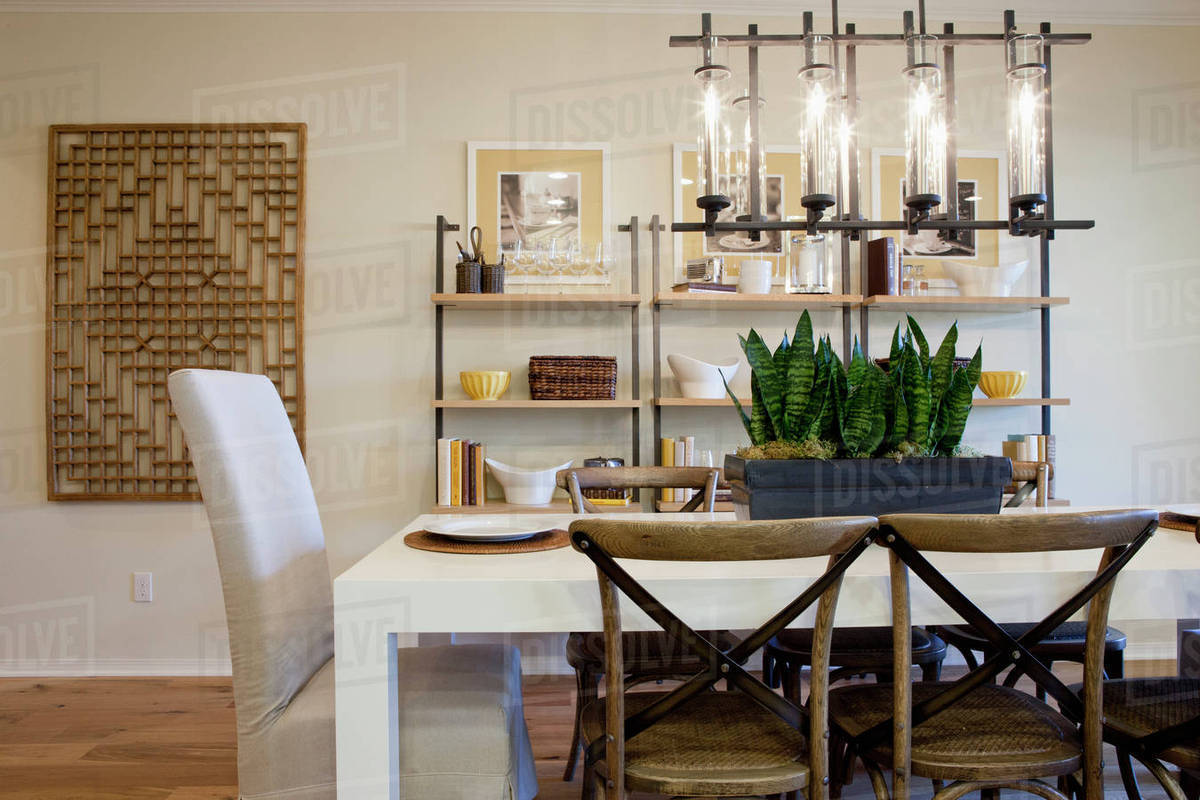 at home chairs replica wegner dining table with shelves in the background