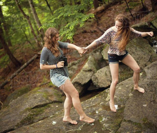 Girls Walking Barefoot On Boulder In Forest