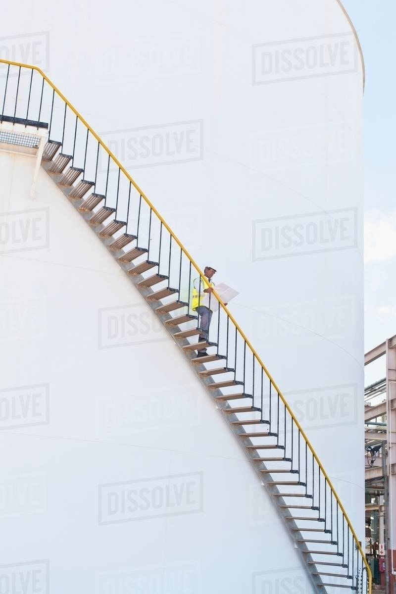 worker climbing steps at