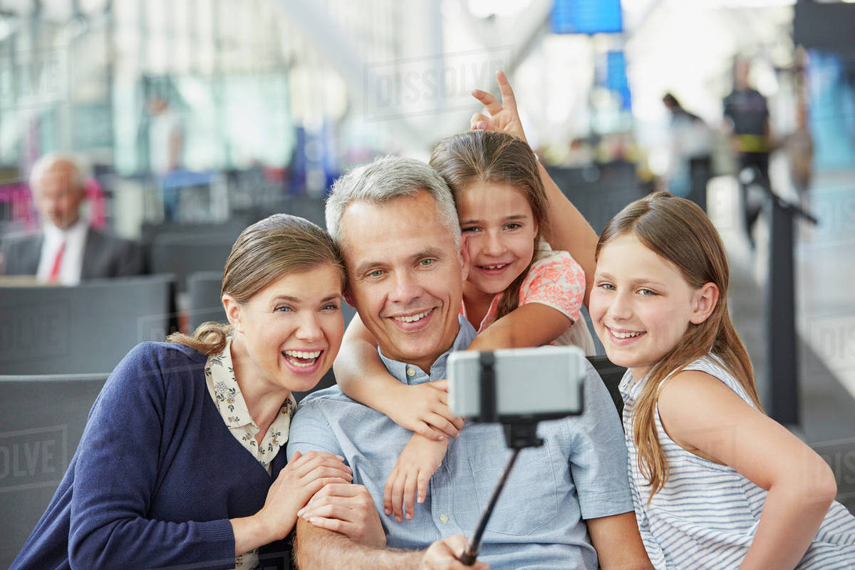 family taking selfie with