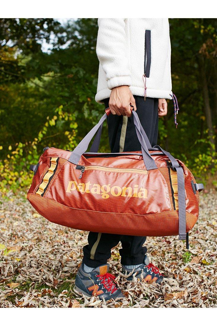 Patagonia Black Hole 60l Duffel Bag In Orange For Men Lyst