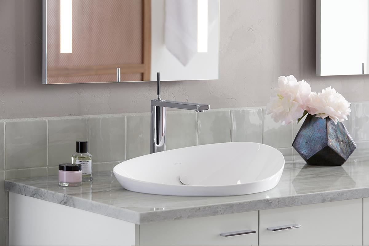 a minimalist bathroom sink by kohler