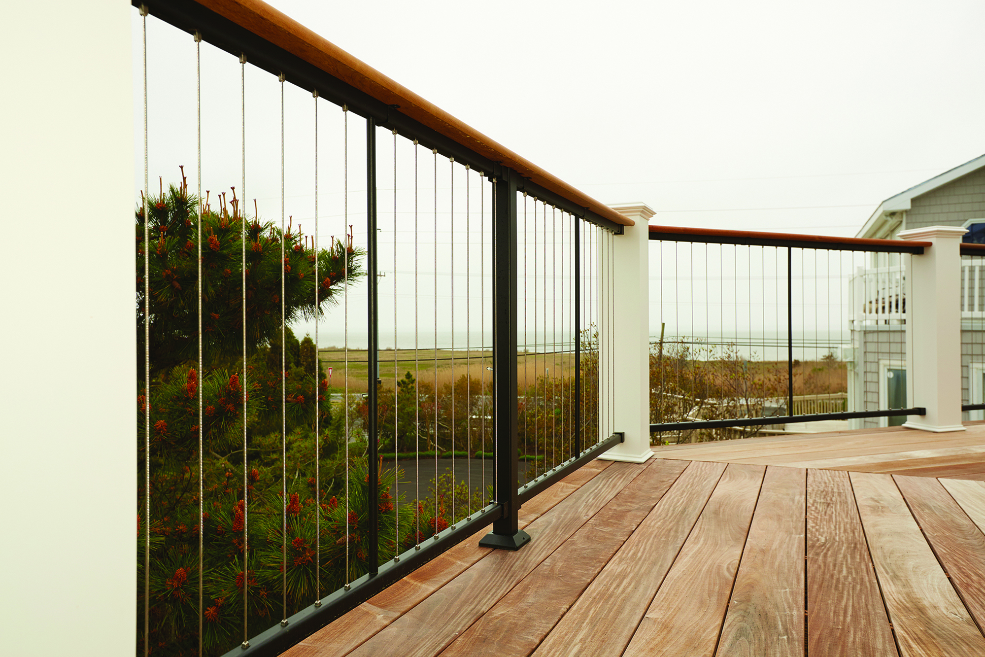 Vertical Cable Rail  Professional Deck Builder  Fencing and Railing