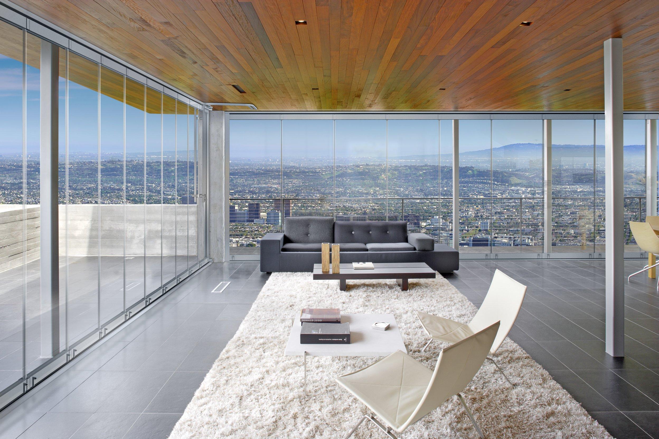 new frameless sliding glass doors protect homes from the elements builder magazine