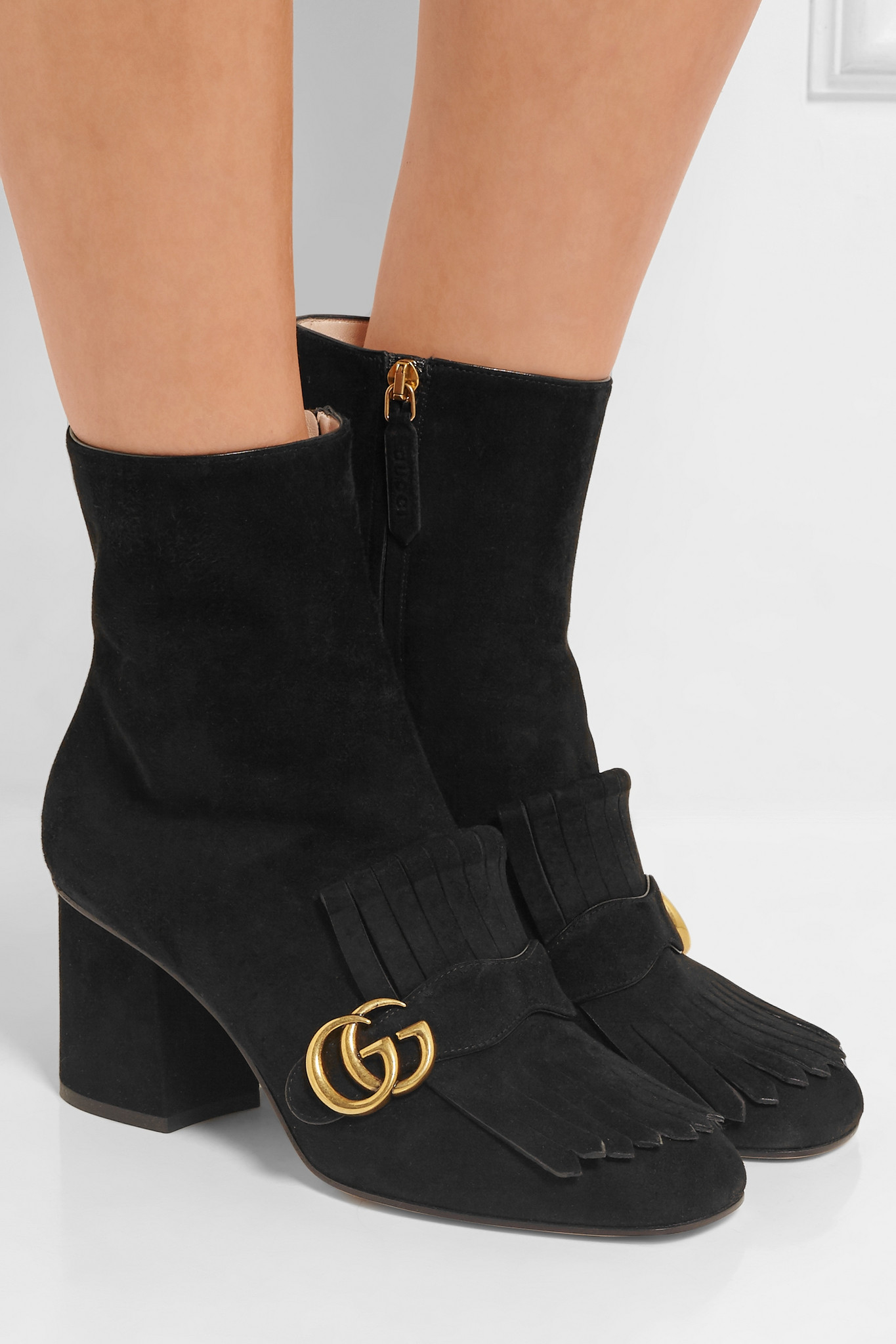 Lyst  Gucci Fringed Suede Ankle Boots in Black