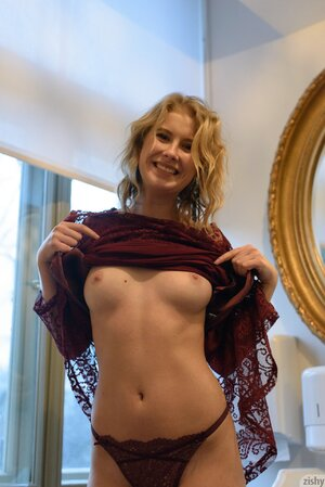Tight blonde chick enjoys demonstrating her tiny boobs