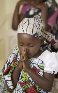 A child from East Angola prays.